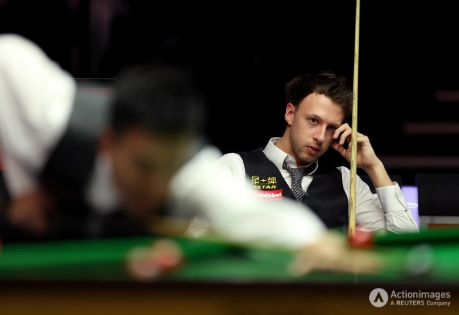 Judd Trump looks dejected during the first roundsteven paston keep