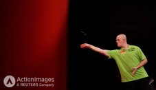 Darts - 2011 Ladbrokes.com World Darts Championship - Alexandra Palace, London - 21/12/10 Michael van Gerwen in action during his first round match Mandatory Credit: Action Images / Steven Paston Livepic