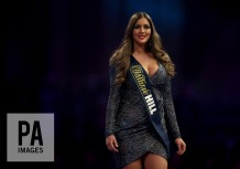 A ache girl during the walk on during day twelve of the William Hill World Darts Championship at Alexandra Palace, London. PRESS ASSOCIATION Photo. Picture date: Thursday December 28, 2017. See PA story DARTS World. Photo credit should read: Steven Paston/PA Wire. RESTRICTIONS: Use subject to restrictions. Editorial use only. No commercial use.