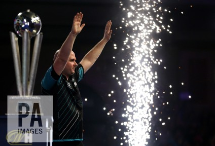 Rob Cross celebrates with the trophy after winning the final during day fifteen of the William Hill World Darts Championship at Alexandra Palace, London. PRESS ASSOCIATION Photo. Picture date: Monday January 1, 2018. See PA story DARTS World. Photo credit should read: Steven Paston/PA Wire. RESTRICTIONS: Use subject to restrictions. Editorial use only. No commercial use.