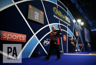 Phil Taylor reacting during day fifteen of the William Hill World Darts Championship at Alexandra Palace, London. PRESS ASSOCIATION Photo. Picture date: Monday January 1, 2018. See PA story DARTS World. Photo credit should read: Steven Paston/PA Wire. RESTRICTIONS: Use subject to restrictions. Editorial use only. No commercial use.