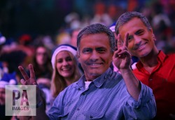 Fans wearing José Mourinho mask during the semi final match during day fourteen of the William Hill PDC World Championship at Alexandra Palace, London. PRESS ASSOCIATION Photo. Picture date: Saturday January 2, 2016. See PA story DARTS World. Photo credit should read: Steve Paston/PA Wire. Use subject to restrictions. Editorial use only. No commercial use. Call +44 (0)1158 447447 for further information.